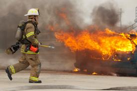 NY firefighter injured battling blazing truck