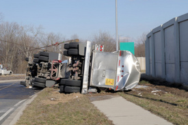 M.A. Truck Accident Report: Semi flips over in Beverly