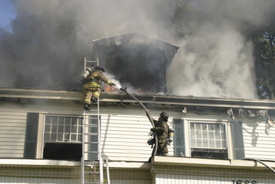 Firefighter injured, woman killed in Randolph house fire