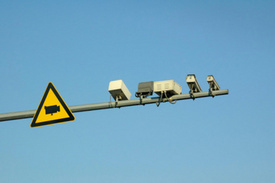 Miami Injury Lawyers Alert: Red-Light Cameras: Boost to Safety, or Big Worries?